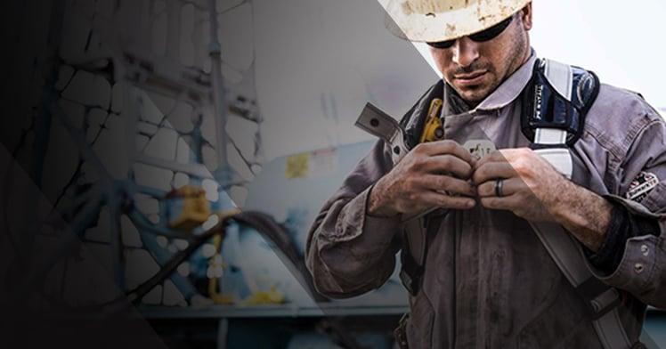Oil worker Donning Bulwark FR Clothing
