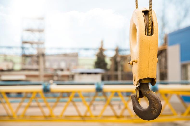 Crane in front of industrial building