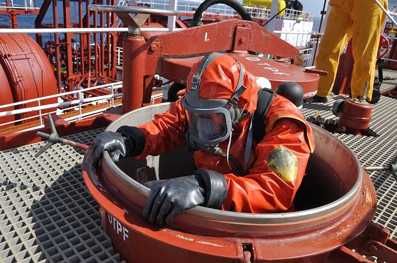 Worker entering a confined space