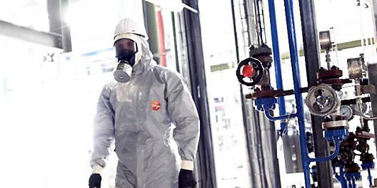 worker wearing disposable coveralls