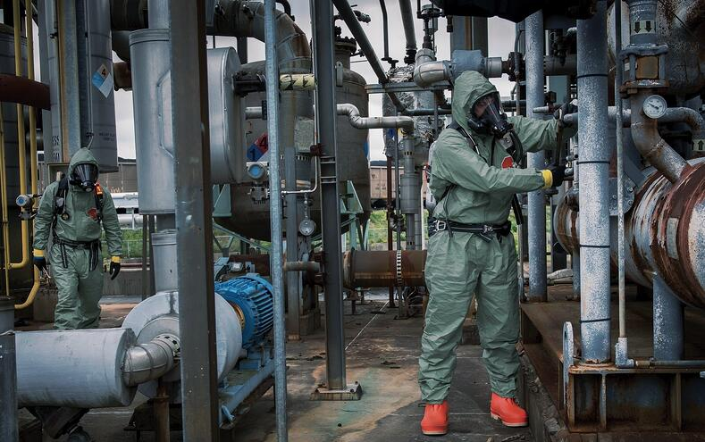 Workers in tychem 2000 sfr coveralls