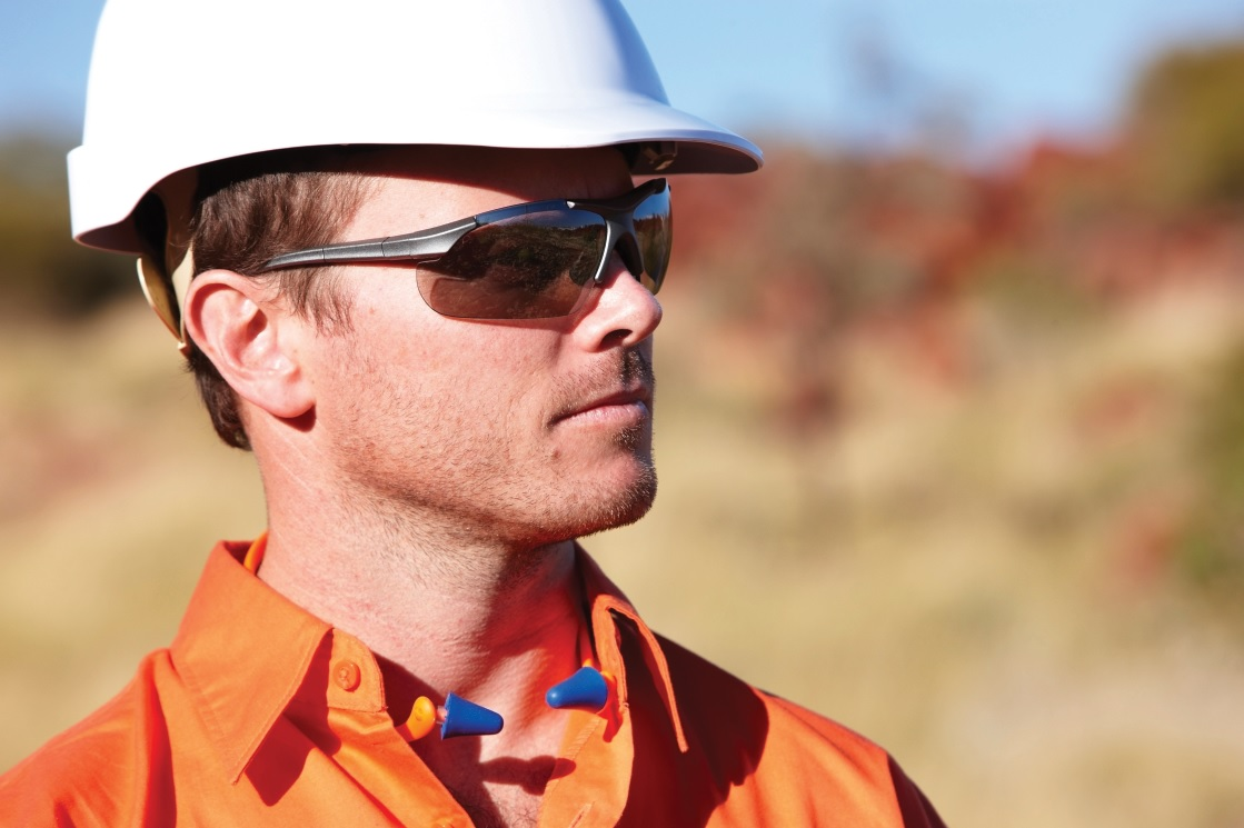 Worker wearing uv protective safety glasses