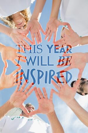 Volunteers with hands together against blue sky against i will be inspired